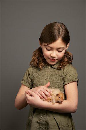 Girl Petting Hamster Stock Photo - Premium Royalty-Free, Code: 600-01236605