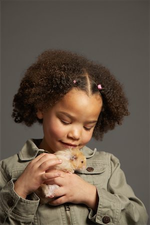 Girl Petting Hamster Stock Photo - Premium Royalty-Free, Code: 600-01236606