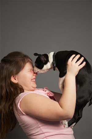 dog kissing girl - Girl with Dog Stock Photo - Premium Royalty-Free, Code: 600-01236600