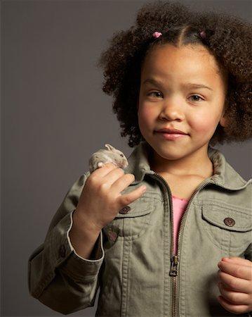 Girl Holding Hamster Stock Photo - Premium Royalty-Free, Code: 600-01236610