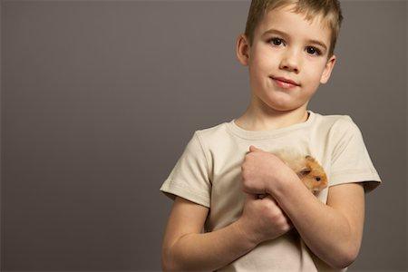 Portrait of Boy Holding Hamster Stock Photo - Premium Royalty-Free, Code: 600-01236613