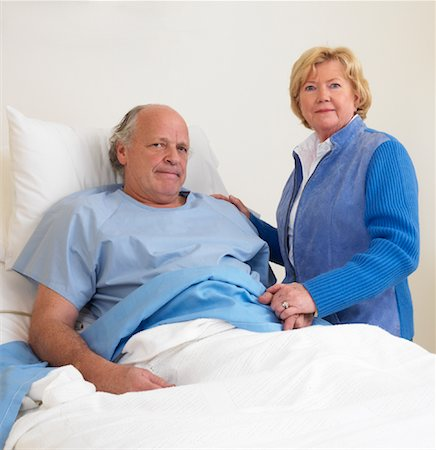 Woman with Sick Man in Hospital Room Stock Photo - Premium Royalty-Free, Code: 600-01248234
