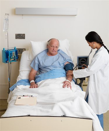 Doctor Checking Blood Pressure of Patient Stock Photo - Premium Royalty-Free, Code: 600-01248238