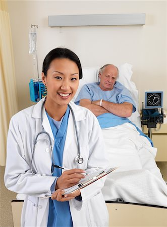 Doctor and Patient in Hospital Room Stock Photo - Premium Royalty-Free, Code: 600-01248239