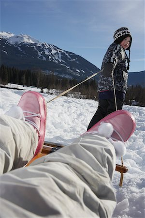 preteen girl feet - Boy Pulling Girl on Sled Stock Photo - Premium Royalty-Free, Code: 600-01248336