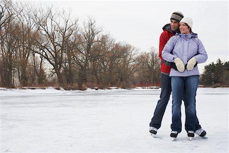 Portrait of Couple Skating Stock Photo - Premium Royalty-Free, Code: 600-01249379