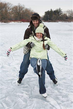 Man Catching Woman while Skating Stock Photo - Premium Royalty-Free, Code: 600-01249411