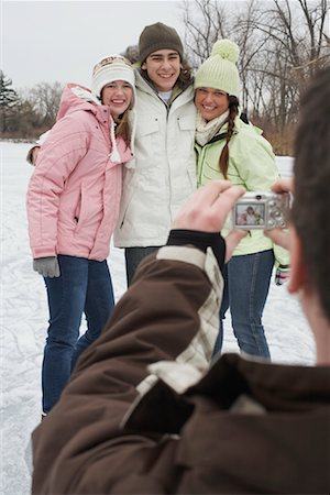 Friends Having Picture Taken Stock Photo - Premium Royalty-Free, Code: 600-01249427