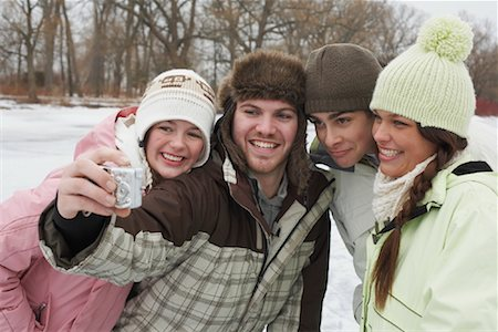 Friends Taking Pictures Stock Photo - Premium Royalty-Free, Code: 600-01249428