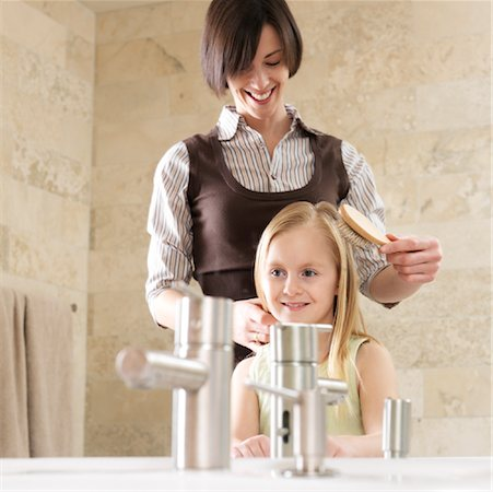 Mother Brushing Daughter's Hair Stock Photo - Premium Royalty-Free, Code: 600-01260384
