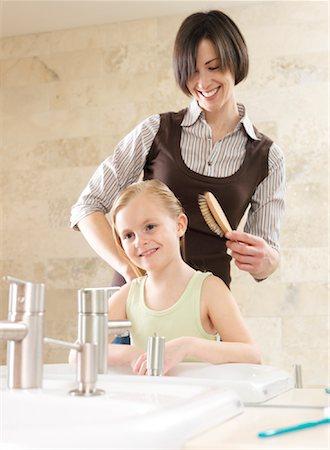 Mother Brushing Daughter's Hair Stock Photo - Premium Royalty-Free, Code: 600-01260385