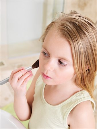 Girl Applying Blush Stock Photo - Premium Royalty-Free, Code: 600-01260392