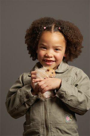 Girl Holding Hamster Stock Photo - Premium Royalty-Free, Code: 600-01275389
