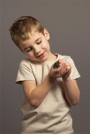Little Boy Holding Hamster Stock Photo - Premium Royalty-Free, Code: 600-01275391