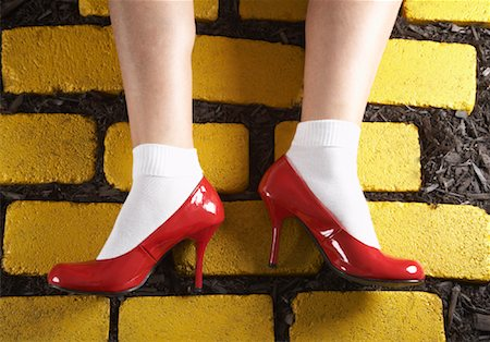 Red Shoes on Yellow Bricks Stock Photo - Premium Royalty-Free, Code: 600-01275978