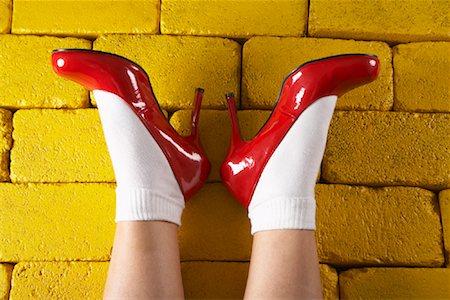 Red Shoes on Yellow Bricks Stock Photo - Premium Royalty-Free, Code: 600-01275979
