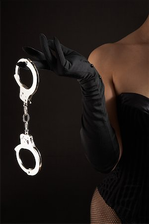 Woman Holding Handcuffs Stock Photo - Premium Royalty-Free, Code: 600-01276003