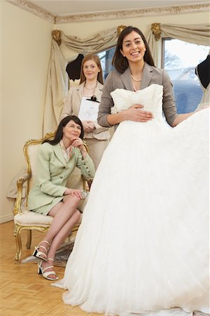 Saleswoman and Clients in Bridal Boutique Stock Photo - Premium Royalty-Free, Code: 600-01276314