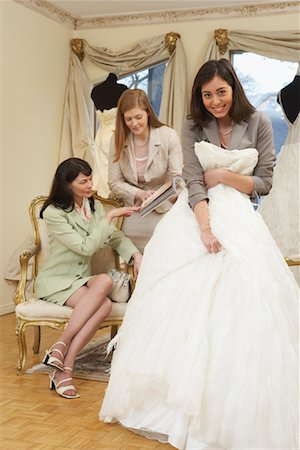 Saleswoman and Clients in Bridal Boutique Stock Photo - Premium Royalty-Free, Code: 600-01276315
