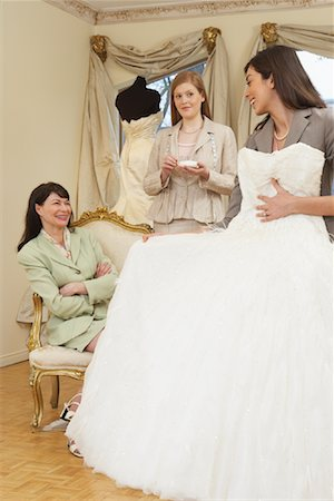 Saleswoman and Clients in Bridal Boutique Stock Photo - Premium Royalty-Free, Code: 600-01276316
