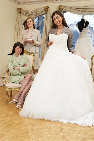 Saleswoman and Clients in Bridal Boutique Stock Photo - Premium Royalty-Free, Code: 600-01276317