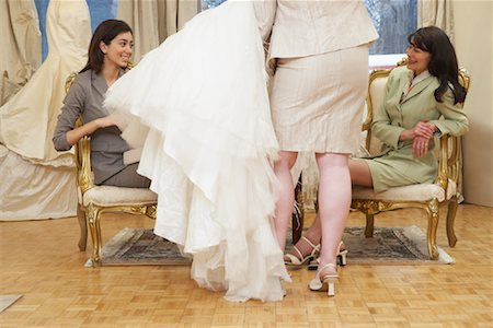 Women in Bridal Boutique Looking at Wedding Gown Stock Photo - Premium Royalty-Free, Code: 600-01276313