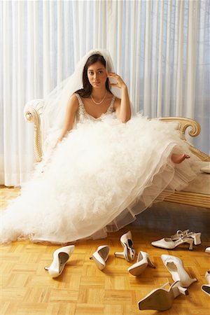 Woman in Bridal Boutique Trying on Shoes Stock Photo - Premium Royalty-Free, Code: 600-01276337