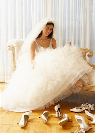 Woman in Bridal Boutique Trying on Shoes Stock Photo - Premium Royalty-Free, Code: 600-01276338