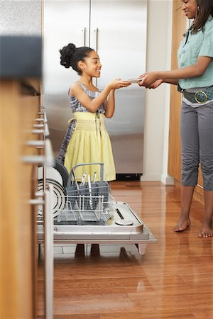 picture black girl washing dishes - Sisters Unloading Dishwasher Stock Photo - Premium Royalty-Free, Code: 600-01276404