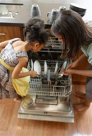 picture black girl washing dishes - Sisters Loading Dishwasher Stock Photo - Premium Royalty-Free, Code: 600-01276405