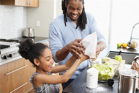 Father and Daughter Making Applesauce in Kitchen Stock Photo - Premium Royalty-Free, Code: 600-01276409