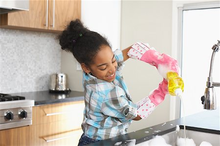 picture black girl washing dishes - Girl Washing Dishes Stock Photo - Premium Royalty-Free, Code: 600-01276414