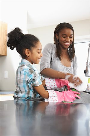 picture black girl washing dishes - Girls Washing Dishes Stock Photo - Premium Royalty-Free, Code: 600-01276415