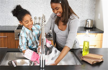 picture black girl washing dishes - Sisters Washing Dishes Stock Photo - Premium Royalty-Free, Code: 600-01276416