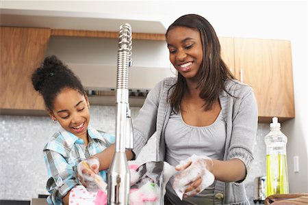 picture black girl washing dishes - Sisters Washing Dishes Stock Photo - Premium Royalty-Free, Code: 600-01276417
