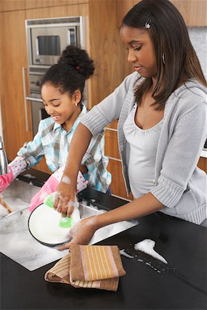 picture black girl washing dishes - Sisters Washing Dishes Stock Photo - Premium Royalty-Free, Code: 600-01276418