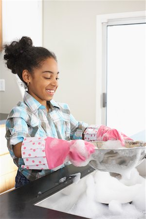 picture black girl washing dishes - Girl Washing Dishes Stock Photo - Premium Royalty-Free, Code: 600-01276413