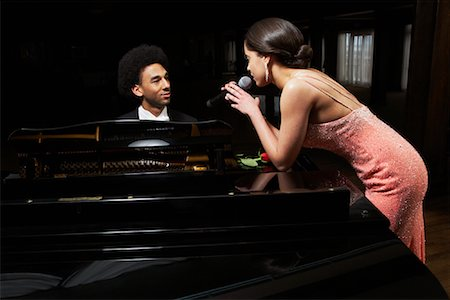 Pianist and Singer in Concert Stock Photo - Premium Royalty-Free, Code: 600-01295572