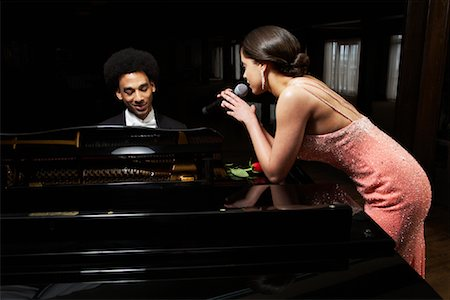 Pianist and Singer in Concert Stock Photo - Premium Royalty-Free, Code: 600-01295573