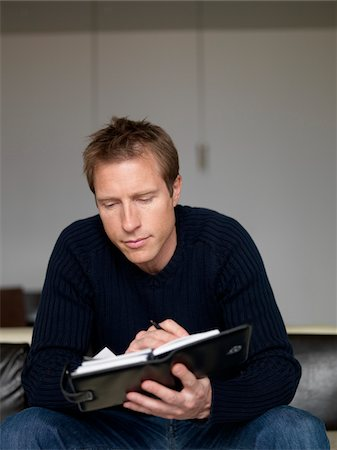 Man Looking at Appointment Book Stock Photo - Premium Royalty-Free, Code: 600-01295809