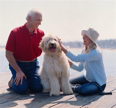 Couple with Dog on Wharf Stock Photo - Premium Royalty-Free, Code: 600-01296398