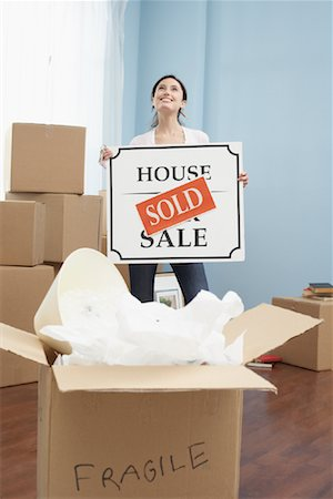 sold sign - Couple Holding Sold Sign in New Home Stock Photo - Premium Royalty-Free, Code: 600-01345111
