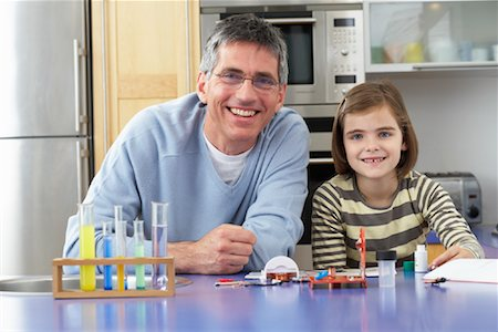Father Helping Daughter With Homework Stock Photo - Premium Royalty-Free, Code: 600-01374083