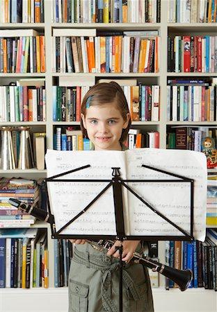 Girl Holding Clarinet Stock Photo - Premium Royalty-Free, Code: 600-01374109