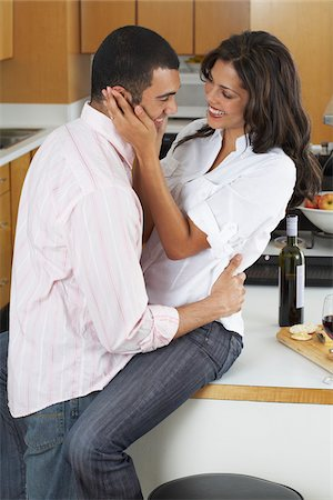 sexually aroused woman - Couple in Kitchen Stock Photo - Premium Royalty-Free, Code: 600-01463694