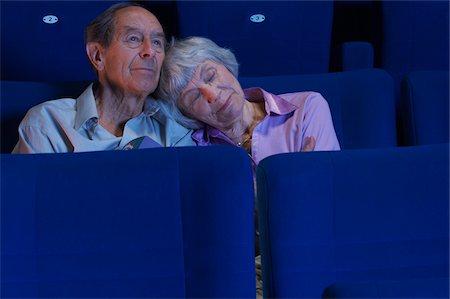 sleepy old woman - Couple in Movie Theatre Stock Photo - Premium Royalty-Free, Code: 600-01572003