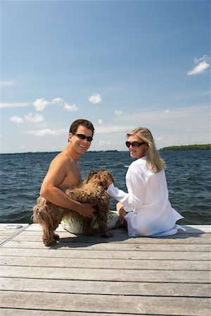 dog in heat - Couple on Dock With Dog Stock Photo - Premium Royalty-Free, Code: 600-01585675