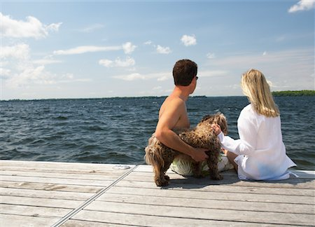 dog in heat - Couple on Dock With Dog Stock Photo - Premium Royalty-Free, Code: 600-01585676