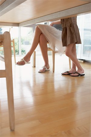 preteen thong - View of People's Legs Under Table Stock Photo - Premium Royalty-Free, Code: 600-01582267