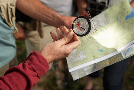 People in Woods with Compass and Map Stock Photo - Premium Royalty-Free, Code: 600-01606165